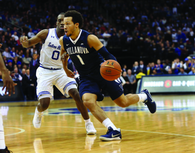 Villanova's Jalen Brunson (1) drives to the basket as Seton Hall's Khadeen Carrington (0) defends during the first half of an NCAA college basketball game, Saturday, Feb. 18, 2017, in Newark, N.J. (AP Photo/Mel Evans)