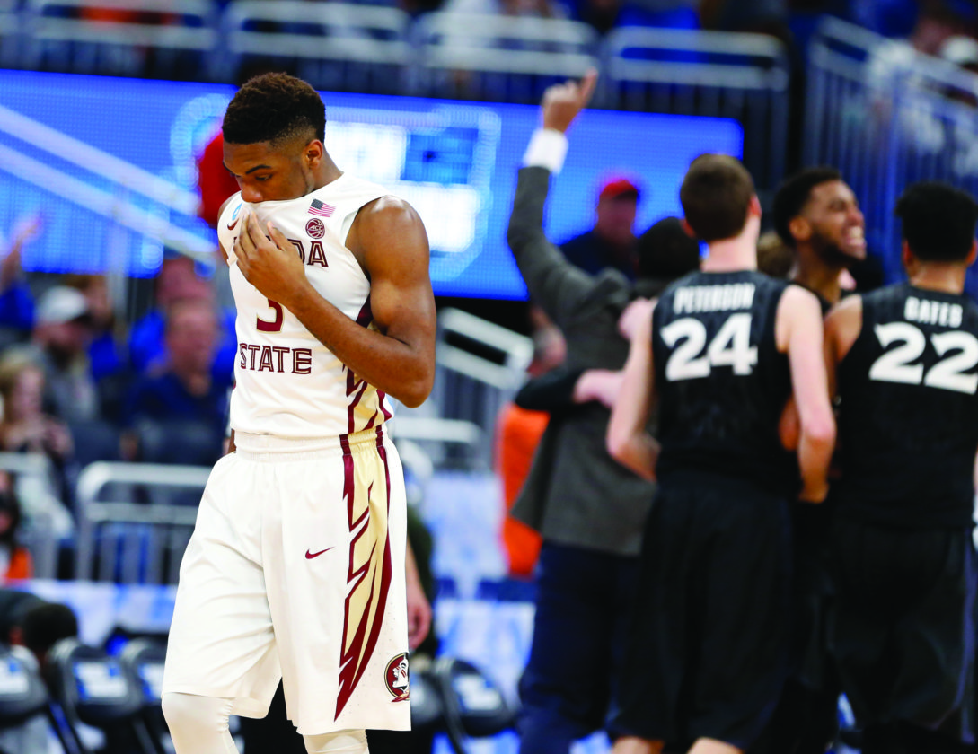 Florida State guard Trent Forrest (3) heads off the court after Xavier defeated Florida State 91-66 during second-round game of the NCAA men's college basketball tournament, Saturday, March 18, 2017, in Orlando, Fla. (AP Photo/Wilfredo Lee)