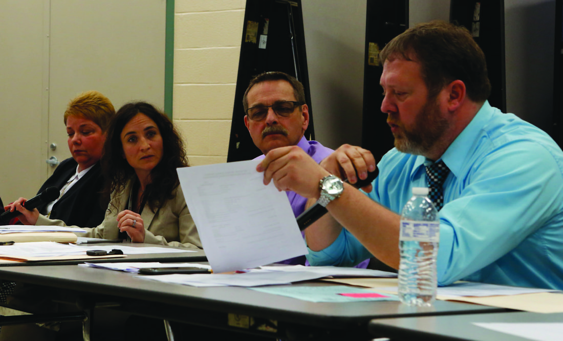 SPENCER MCCOY/THE EXPRESS Rising costs were at center stage last night at the Keystone Central School Board's property and finance committee meeting. Shown talking costs are, from left, Superintendent Kelly Hastings, business manager Susan Blesh and board members Jeff Johnston and Roger Elling.