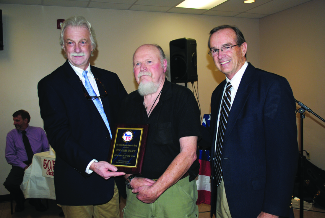 Dan Reeder, center, and his wife Rose (not in attendance) were named Democrats of the Year. At left is Joe Waltz, Clinton County Democratic Party chairman. At right is State Rep. Mike Hanna.