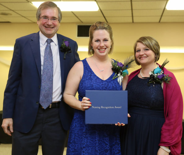 "PHOTO PROVIDED Daniel Glunk, MD, vice president and chief quality officer of UPMC Susquehanna, presents Amanda Raymond, RN, with the ""Above Clinical Excellence (ACE)"" Educator Award. At right is Raymond's manager, Lesha Trostle, BSN, RN-BC."
