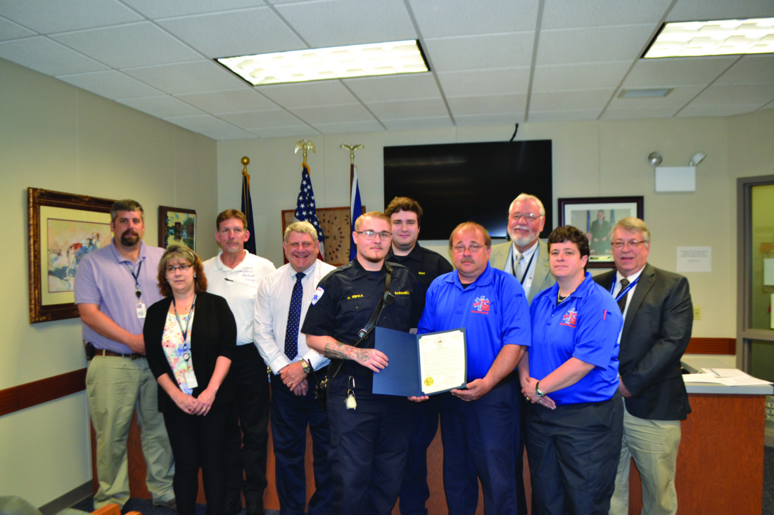 BOB ROLLEY/The Express Emergency medical services providers were honored by the Clinton County commissioners on Thursday. From left are Dan Ake, Susan Watson, Dave Knauff, Commissioner Jeff Snyder, Evan Ripka, Troy Bruner, Gerard Banfill, Commissioner Pete Smeltz, Ann Banfill and Commissioner Paul Conklin.