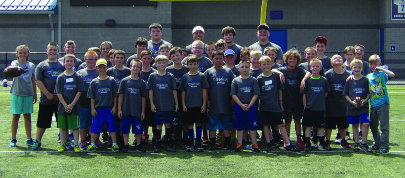 Boys and girls, grades second through sixth, posed for a photo at a youth football camp that was sponsored by Central Mountain High School student-athletes as a senior project. (Photo Provided)