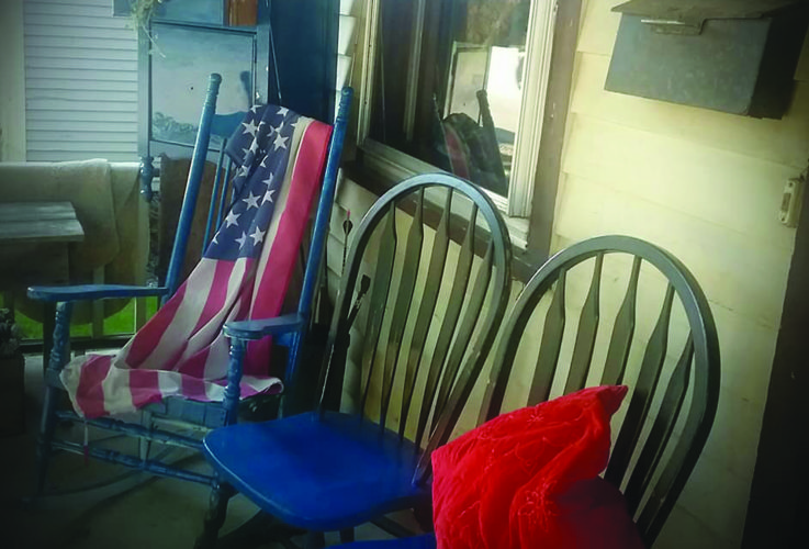AMBER MORRIS/THE EXPRESS Front porches like this one in Loganton are excellent for 'porch sitting' in rural areas.