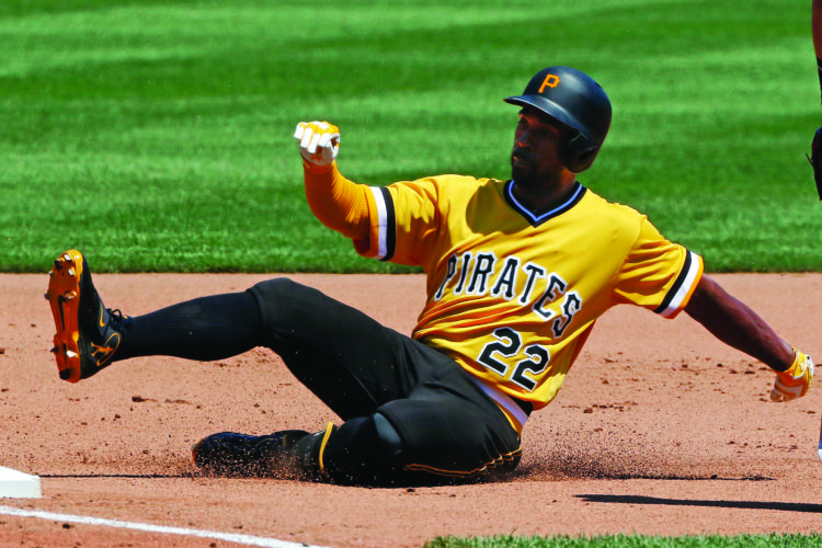 Pittsburgh Pirates' Andrew McCutchen slides safely into third with a triple off Miami Marlins relief pitcher Jeff Locke in the fourth inning of a baseball game in Pittsburgh, Sunday, June 11, 2017. (AP Photo/Gene J. Puskar)