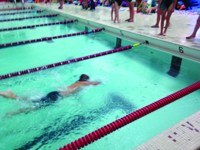 Lock Haven's Neil Kaluzny at the half-point in his 50 yard freestyle. (Photo Provided)