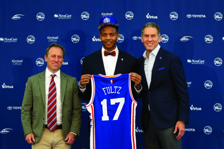 Philadelphia 76ers' draft pick Markelle Fultz, center, poses with team president Bryan Colangelo, right, and managing owner Josh Harris after a news conference at the team's NBA basketball training complex, Friday, June 23, 2017, in Camden, N.J. (AP Photo/Matt Slocum)