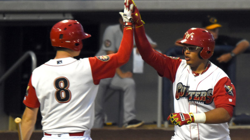 Williamsport Crosscutters' Jhailyn Ortiz (right) celebrates with  infielder Greg Pickett after scoring a run. (Photo courtesy of Williamsport Crosscutters)