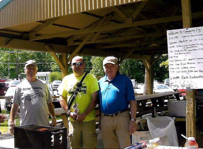 PHOTO PROVIDED Porter Township supervisors cooked free hot dogs for the community at the first Community Day. From left are Larry Dotterer, Kevin Frank and Mike Champion.