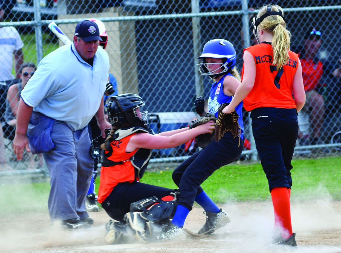 MARK NANCE/Sun-Gazette Jersey Shore catcher ? ? ?  tags out South Williamsport's 7 on a passed pitch in the second inning.