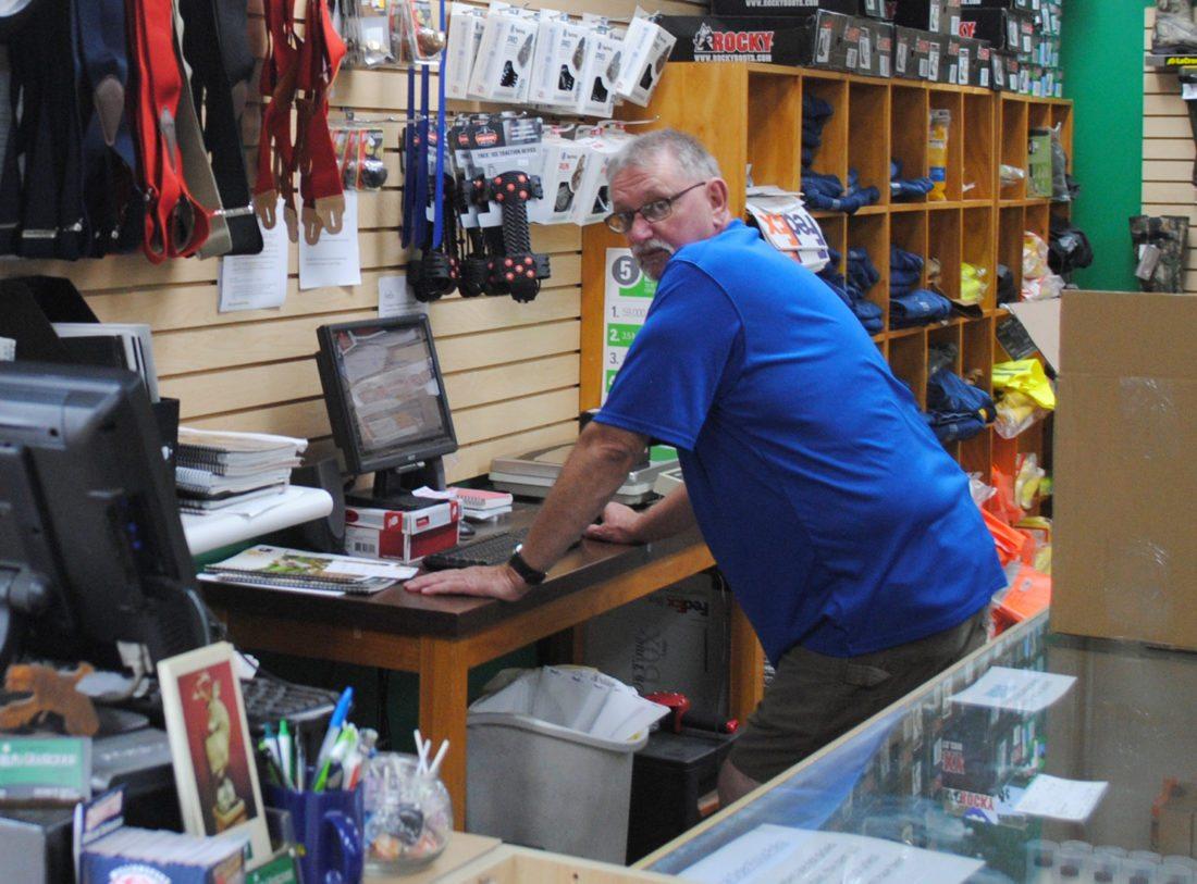 JORDAN SLOBODINSKY/THE EXPRESS Bob Simcox stands behind the cash register in his store, Corbin's Footwear.