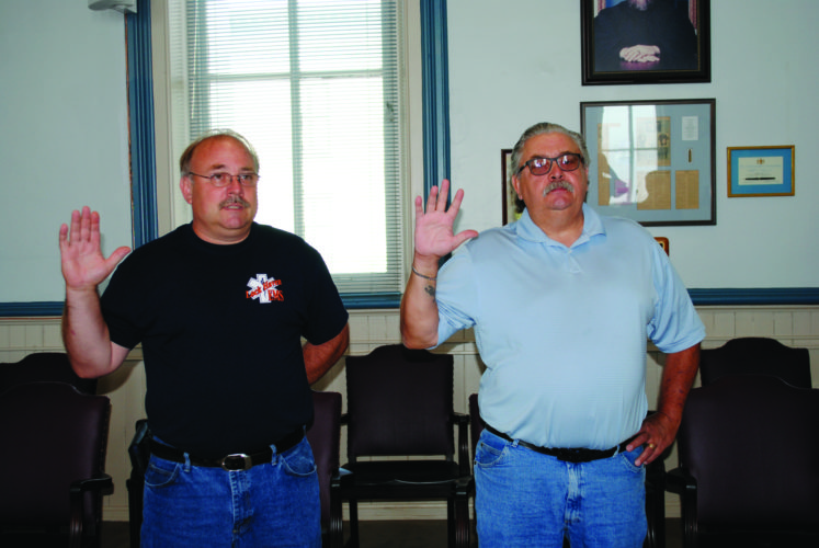 LANA MUTHLER/THE EXPRESS Two new Bald Eagle Township supervisors — Gerald L. Banfill, left, and Clarence L. Rine — were sworn in by Clinton County President Judge Craig P. Miller on Monday afternoon. They will take their seats at the township supervisors table on Monday, July 24.