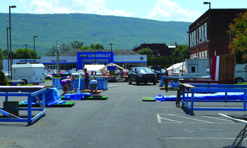 Jordan Slobodinsky/The Express Volunteers help to set up the game booths and food stations at Saint Agnes in Lock Haven. There will be food for sale as well as games to play. The fair is this Thursday through Saturday.