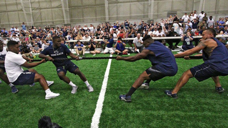 The Penn State offensive takes on the defense in the tug-o-war at the 15th Annual Penn State Lift for Life on July 15, 2017.  The event  presented by the Penn State Chapter of Uplifting Athletes benefits the rare disease community.  Photo/Craig Houtz