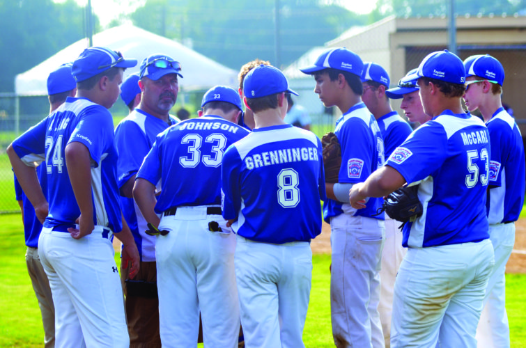 The Keystone Junior All-Stars baseball team huddles up in the middle of innings in an All-Stars game against Sayre. The game was suspended after nine innings due to darkness and will resume today at 4:30 PM in New Berlin. (The Express/Shareik Flowers)