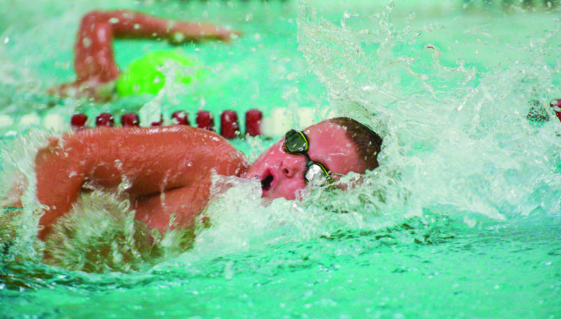 Lock Haven's Jacob Rembold sprinting down the lane in the 25 yard freestyle for a second place finish. (PHOTO PROVIDED)
