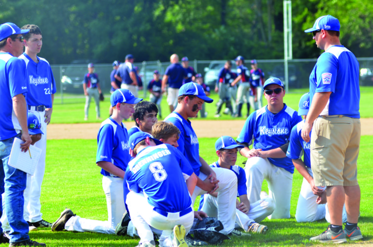 The Keystone (Juniors) team huddles after suffering a 10-7 loss to Sayre in the opening round of the Sectionals tournament. (THE EXPRESS/SHAREIK FLOWERS)