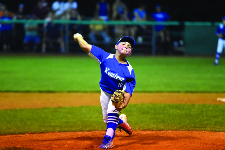 Gardy Fravel (10) of the Keystone 9-11 All-Stars throws a pitch against the Pottsville All-Stars last night in Beech Creek. Keystone moves on in the sectional tournament after defeating Pottsville, 14-2. (THE EXPRESS/TIM WEIGHT)