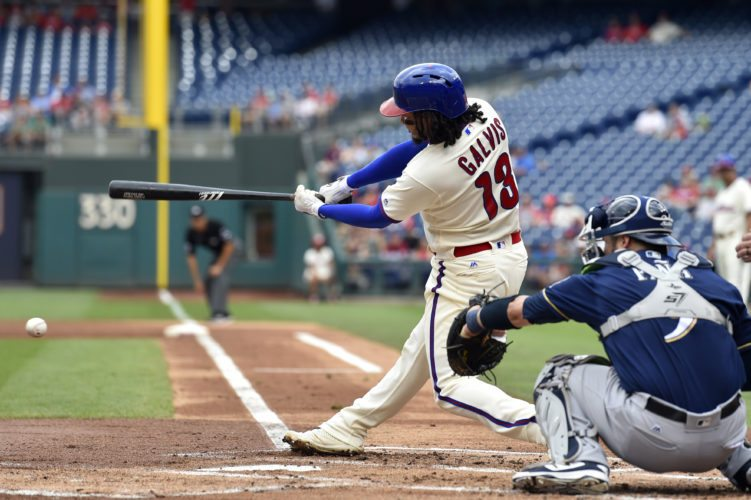 Philadelphia Phillies' Freddy Galvis hits infield single on an error by Milwaukee Brewers' Jonathan Villar during the first inning of a baseball game, Sunday, July 23, 2017, in Philadelphia. (AP Photo/Derik Hamilton)