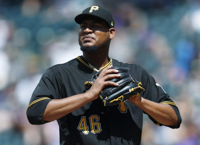 Pittsburgh Pirates starting pitcher Ivan Nova reacts after giving up a two-run home run to Colorado Rockies' Trevor Story in the sixth inning of a baseball game Sunday, July 23, 2017, in Denver. (AP Photo/David Zalubowski)