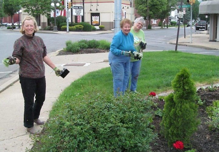 PHOTO PROVIDED Members of the Dogwood Circle Garden Club are seen working on the landscaping at the monument in downtown Lock Haven. From left are Sherry Dwyer, Marion Hoffman, a charter member of the club, and Connie Barker.