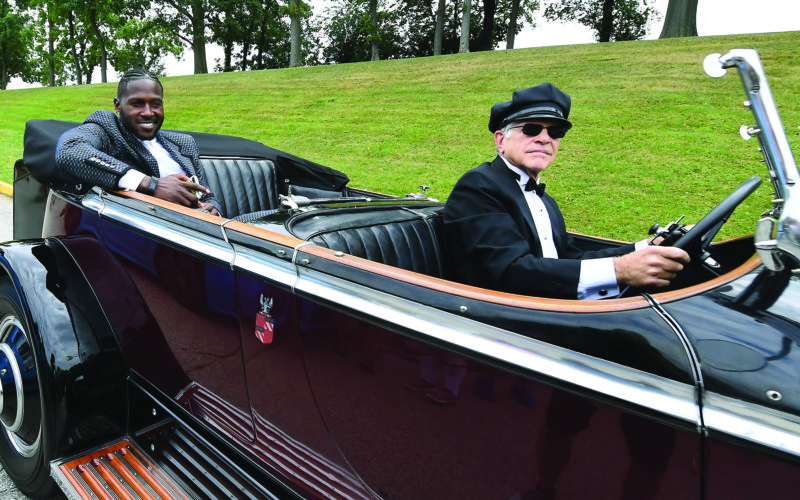 Pittsburgh Steelers NFL football wide receiver and punt returner Antonio Brown, left,  arrives at training camp in a 1931 Rolls Royce Phantom, at Saint Vincent College in Latrobe, Pa., Thursday, July 27, 2017. (Peter Diana/Pittsburgh Post-Gazette via AP)