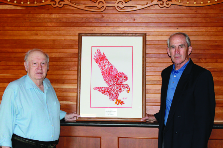 Joseph Desmond Jr., left, of Mill Hall used a Lock Haven University coloring contest image to make this beaded work of art.