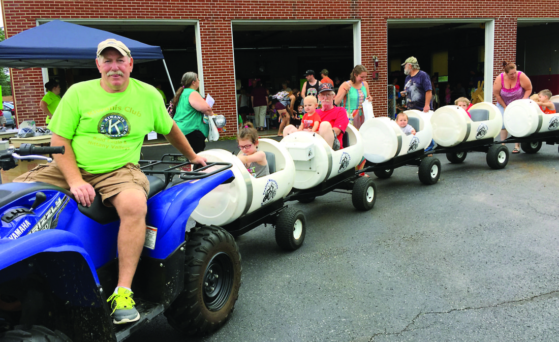 Kiwanis BENV president Tim Meyers prepares to depart the station with the Kids Day cart train for a trip to the nearby Mill Hall park and back. Below, Kingdom Kidz puppeteers entertain and present safety information to kids and family members at Kids Day.