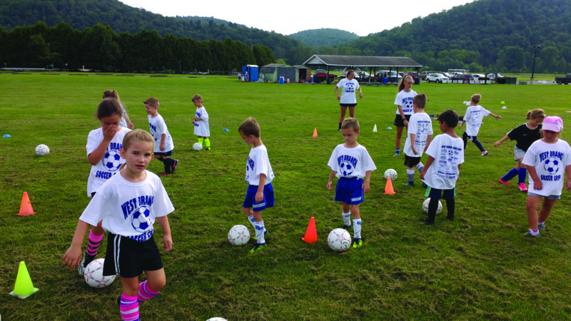Kids practice soccer drills while attending the 2017 West Branch Soccer Camp in Lock Haven last week. (Photo Provided)