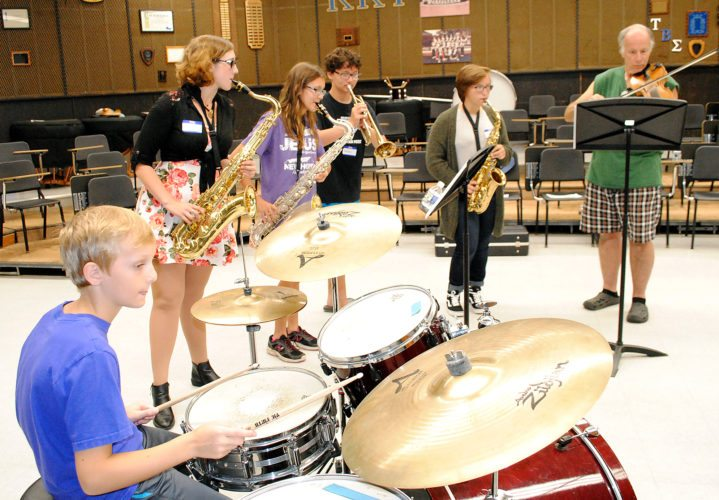 WENDY STIVER/THE EXPRESS Participants in the LH JAMS jazz workshop Friday at LHU include, from left, Luke Severn on drums, Kalina Spring and Rachel Crust on tenor sax, Andrew Haigh on trumpet, Emma Green on alto sax, and Mark Heaton on fiddle. Other participants were vocalist Makayla Key and pianist Mary Lou White.