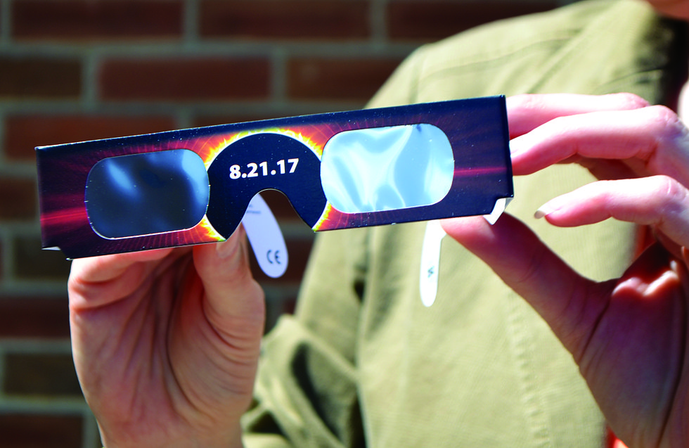 JORDAN SLOBODINSKY/THE EXPRESS Pairs of the solar viewing glasses like these will be distributed to attendees of the lawn party during the eclipse at LHU.