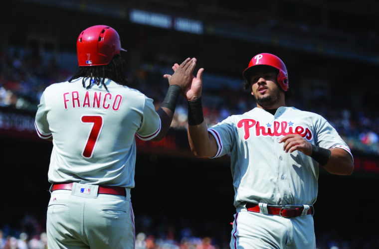 Philadelphia Phillies' Jorge Alfaro, right, celebrates with Maikel Franco (7) after scoring against the San Francisco Giants in the eighth inning of a baseball game, Sunday, Aug. 20, 2017, in San Francisco. Both scored on a single by Phillies' Pedro Florimon. (AP Photo/Ben Margot)