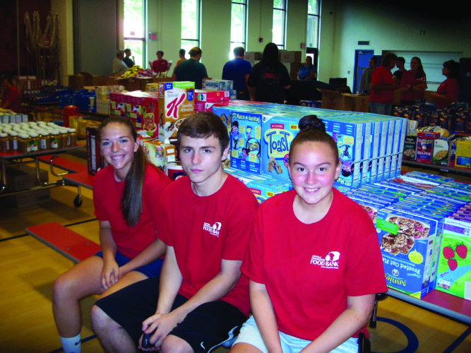 PHOTO PROVIDED   From left, Mariah Kepler, Cody Hand and Alyssa Dickey are pictured. The students distributed lunches to three playgrounds in the Renovo area this summer.