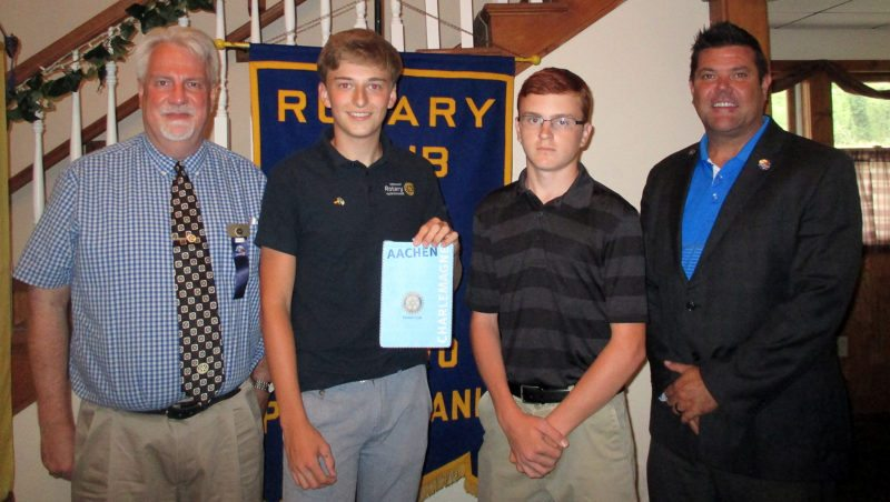 PHOTO PROVIDED At the Aug. 14 meeting of the Rotary Club of Renovo are, from left, club president Dennis Smith, Christoph Meysen from Aachen, Germany who is visiting Renovo through the Rotary Youth Exchange, Ben Probert of the Renovo area who went to Aachen through the same program, and Rotary District Governor Mike Hornby.