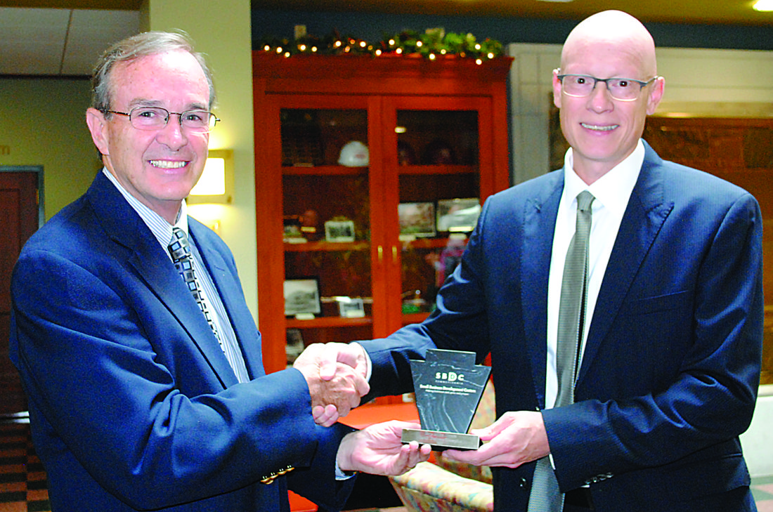 WENDY STIVER/THE EXPRESS State Rep. Mike Hanna, left, was surprised with the Small Business Champion Award. Pennsylvania SBDC State Director Christian Conroy presents him with the honor Tuesday at Lock Haven University.
