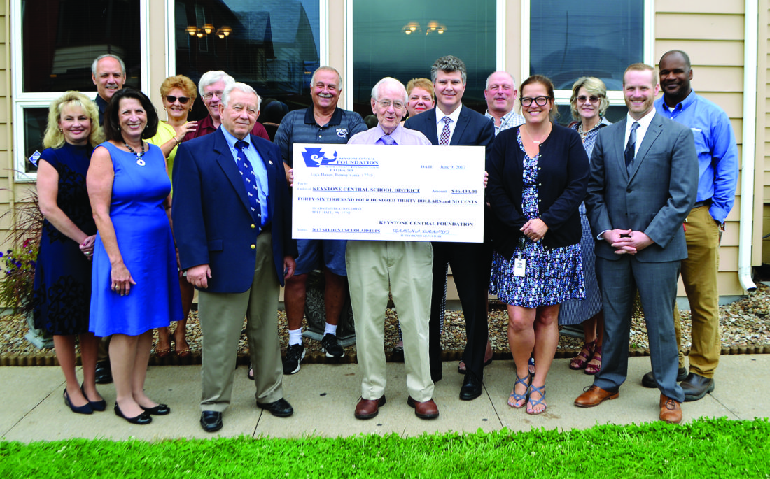 PHOTO PROVIDED Members of the Keystone Central Foundation pose with a mock check for more than $46,000, representing awards given out this past spring to students of the Keystone Central School District to help them with college, trade school and careers. In front, from left, are Karen Brandt, Lea Ann Plessinger, Ron Bowes, Dr. Richard Stuempfle, Stuart Hall, Angela Harding and Zach Hanna. In back, from left, are Bob Rolley, Karen Probst, Wayne Allison, Kliney Williams, Kelly Hastings, Bob Dwyer, Beth Riccardo and Albert Jones. Missing are Jim Berkebile, Leslie Smith, Steve Turchetta and Jack Peters.