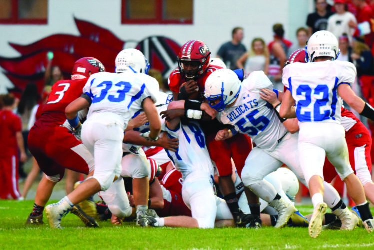 Senior RB/LB Dexter Gallishaw (21) of Bellefonte High School pummels through the Central Mountain offensive line for a gain. The Red Raiders held off Central Mountain High School to win a 34-31 four overtime thriller last Friday night. (The Express/Tim Weight)
