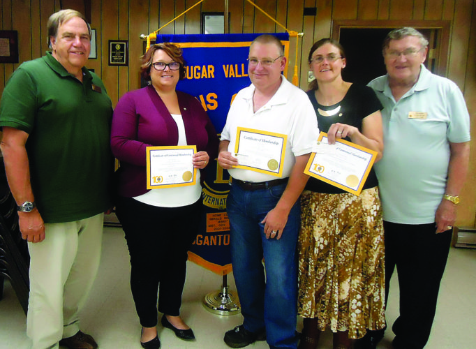 PHOTO PROVIDED From left are Sugar Valley Lions President Bob Mills, new members Destany Etters, Craig Coder and Christina Coder, and Lion Ron Berry. Mills and Berry sponsored the new members.