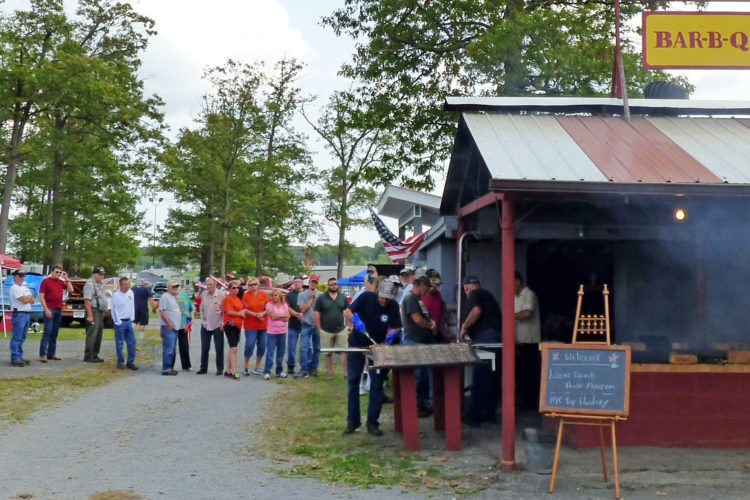 PHOTO PROVIDED Food, music, vintage automobiles and more were part of the 10th Annual Snow Shoe Fall Festival. Here, attendees line up for chicken barbecue.