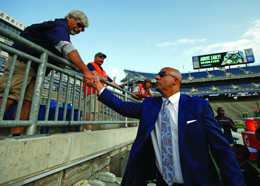 Penn State head coach James Franklin right shakes hands with stadium volunteers as the team arrives to take on Georgia State in an NCAA college football game in State College Pa. Saturday Sept. 16 2017