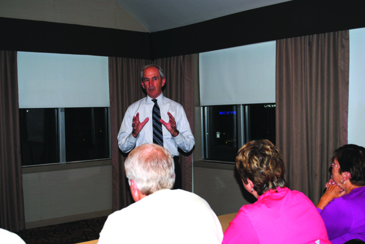 WENDY STIVER/THE EXPRESS Dr. Michael Fiorentino, president of Lock Haven University, talked to other members of the Clinton County Economic Partnership.