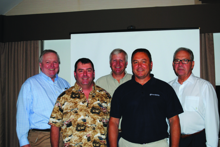 WENDY STIVER/THE EXPRESS Re-elected to the Clinton County Economic Partnership Board were, from left, Bill Hanelly as Lock Haven University's representative, Dave Harger for Harger Utility Contractors, Steve Bason for Cedar Run Environmental Services, Bill Garbrick for First Quality, and Tom Brigandi of Fish Real Estate.