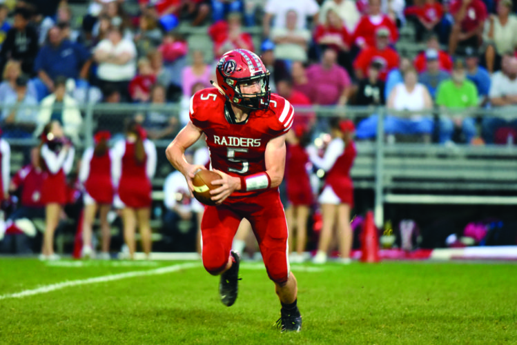 Bellefonte quarterback Dylan Dietrich drops back for a pass in the Red Raiders' four overtime win against Central Mountain last week. Bellefonte hosts Tyrone tonight at 7 p.m.