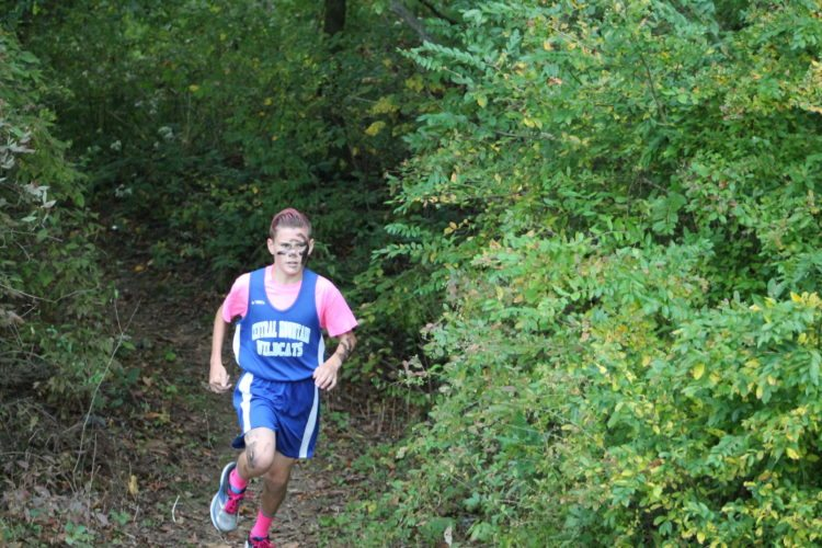 8th grader Gino Serafini exists the woods at the beginning of the race vs. Hollidaysburg and Dubois last week behind Central Mountain Middle School.