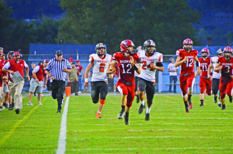 Senior WR/DB Cade Fortney (12) of Bellefonte High School runs for a huge gain against Tyrone High School. The Red Raiders won 49-14. (The Express/Phil Mapstone)
