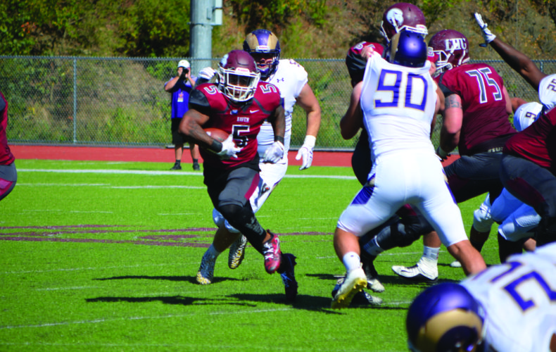 Sophomore running back Ralph Hyland (5) of Lock Haven University runs against the defense of West Chester University. (The Express/Phil Mapstone)