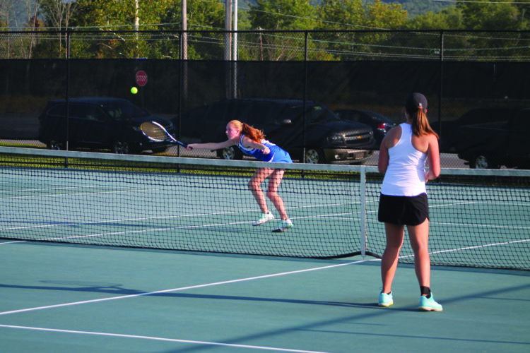 Central Mountain High School sophomore Natalie Brown returns a shot in her doubles match against Jersey Shore High School on Tuesday at Central Mountain in Mill Hall. (The Express/Scott Baker)