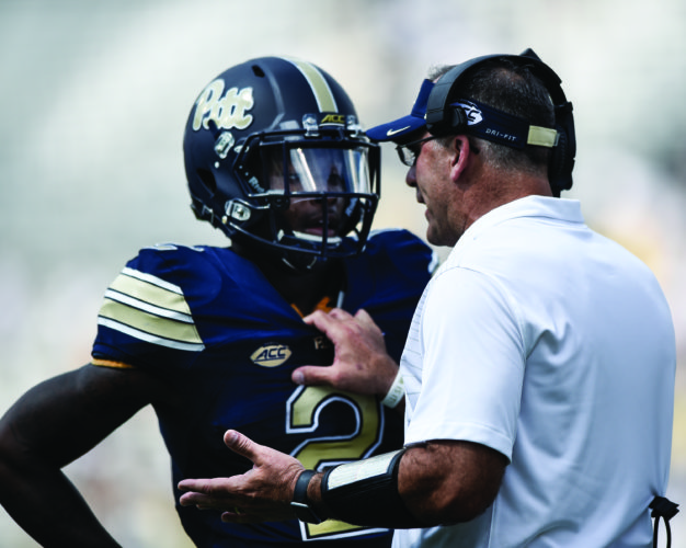Pittsburgh head coach Paul Narduzzi talks to defensive back Maurice Ffrench (2) during the second half of an NCAA college football game against Georgia Tech, Saturday, Sept. 23, 2017, in Atlanta. Georgia Tech won 35-17. (AP Photo/Jon Barash)