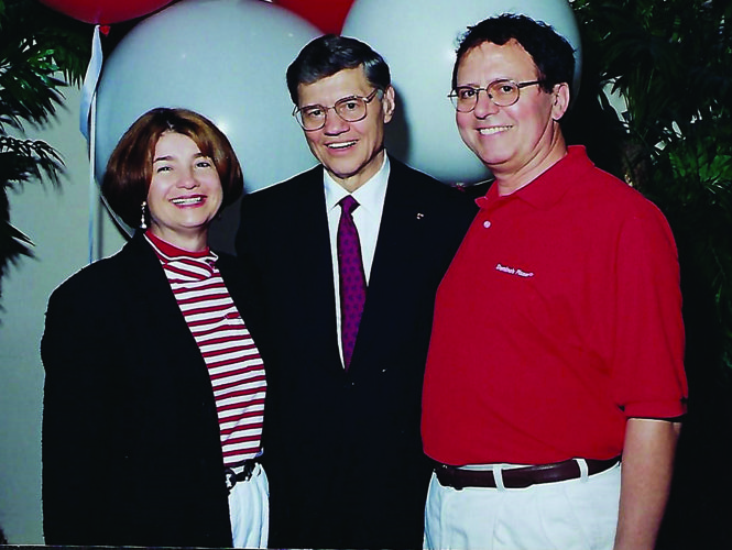 PHOTO PROVIDED Zonda Gregory and her husband Jim, at right, stand next to Domino's Pizza founder, Tom Monaghan, at a meeting for Domino's franchise owners in Las Vegas not too long after the couple opened their flagship business here in Lock Haven.  PHOTO PROVIDED Zonda Gregory and her husband Jim, at right, stand next to Domino's Pizza founder, Tom Monaghan, at a meeting for Domino's franchise owners in Las Vegas not too long after the couple opened their flagship business here in Lock Haven.