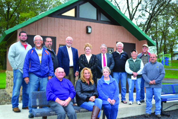 "WENDY STIVER/THE EXPRESS In front of the new restrooms building at Grove Community Park are, from left, seated: Flemington Councilman Dave Grimm, borough secretary Charity Walizer-Etters, and Council Member Jo LaRocque; and standing: borough employee J.R. Probst, Council President Albert ""Hap"" Hill, Councilman Gary Mellott, Clinton County Commissioner Chair Robert ""Pete"" Smeltz, Council Member Traci Kuntz, Commissioner Paul Conklin, Councilman Wayne Allison, friend of the park Paul Powell Jr., Flemington Mayor Gary L. Durkin, and Bald Eagle Township Supervisor Chair Gerard Banfill."